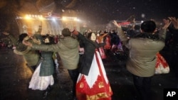 North Koreans dance on the Kim Il Sung Square to celebrate a satellite launch, Feb. 8, 2016, in Pyongyang, North Korea. (AP Photo/Jon Chol Jin)