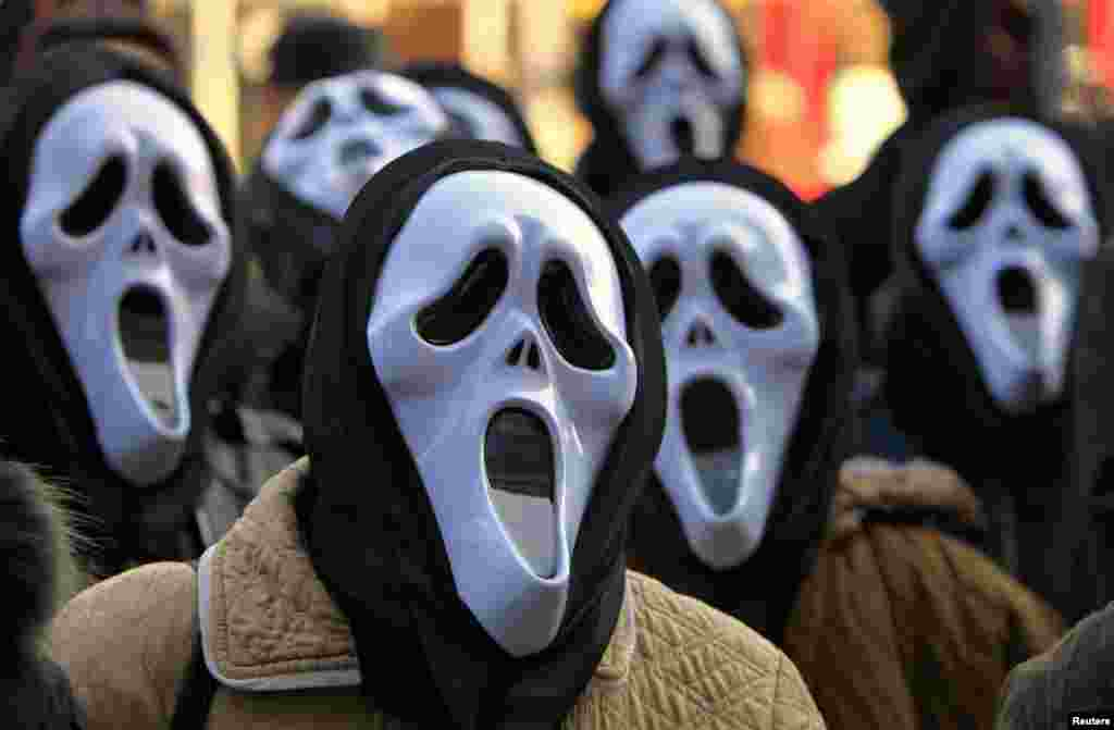 Postal workers wear masks during a protest in front of the state-owned postal service Posta Romana headquarters in Bucharest, Romania, against the treatment by the management.