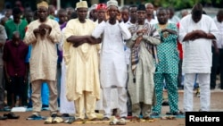 Muslims pray outside a school during celebrations marking Eid al-Adha in Lagos October 15, 2013.