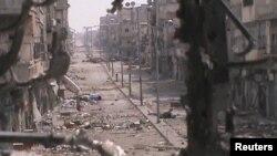 Suriyaning al-Xolidiya shahri, 21-iyun, 2012-yil (Suratni kattalashtirish mumkin)