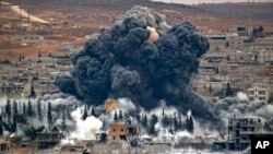 FILE - Smoke rises from the Syrian city of Kobani, following an airstrike by the US led coalition.