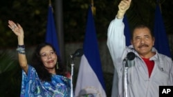 Nicaragua's incumbent president Daniel Ortega and his wife, vice presidential candidate Rosario Murillo, left, wave at supporters after casting their ballots in Managua, Nov. 6, 2016.