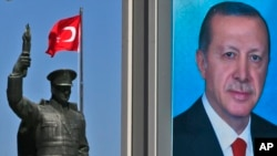 A statue of modern Turkey's founder, Mustafa Kemal Ataturk, and a poster of Turkish President Recep Tayyip Erdogan are seen in his hometown city of Rize ahead of an upcoming referendum, April 4, 2017.