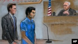In this courtroom sketch, defendant Dias Kadyrbayev, center, a college friend of Boston Marathon bombing suspect Dzhokhar Tsarnaev, is depicted, Aug. 21, 2014 in federal court in Boston during a hearing.