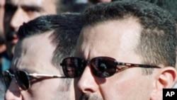 Bashar al-Assad (R) and his younger brother Maher al-Assad, (File)