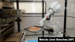 Zume Pizza in California is among many American businesses testing robots for food preparation.