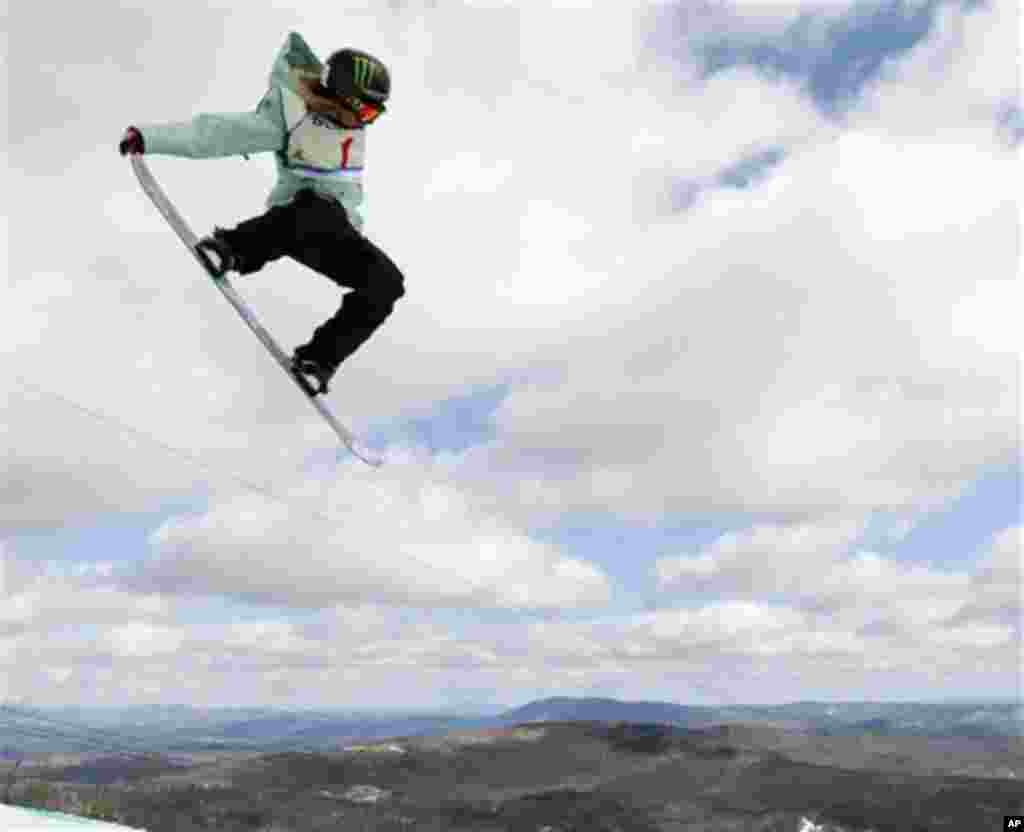 Finland's Enni Rukajarvi competes in the women's slopestyle finals at the U.S. Open Snowboarding Championships in Stratton, Vt., on Friday, March 9, 2012. Rukajarvi finished in third place. (AP Photo/Mike Groll)