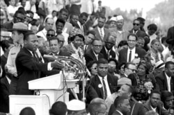 """FILE - In this Aug. 28, 1963 file photo, the Rev. Dr. Martin Luther King Jr., head of the Southern Christian Leadership Conference, speaks to thousands during his """"I Have a Dream"""" speech in front of the Lincoln Memorial"""