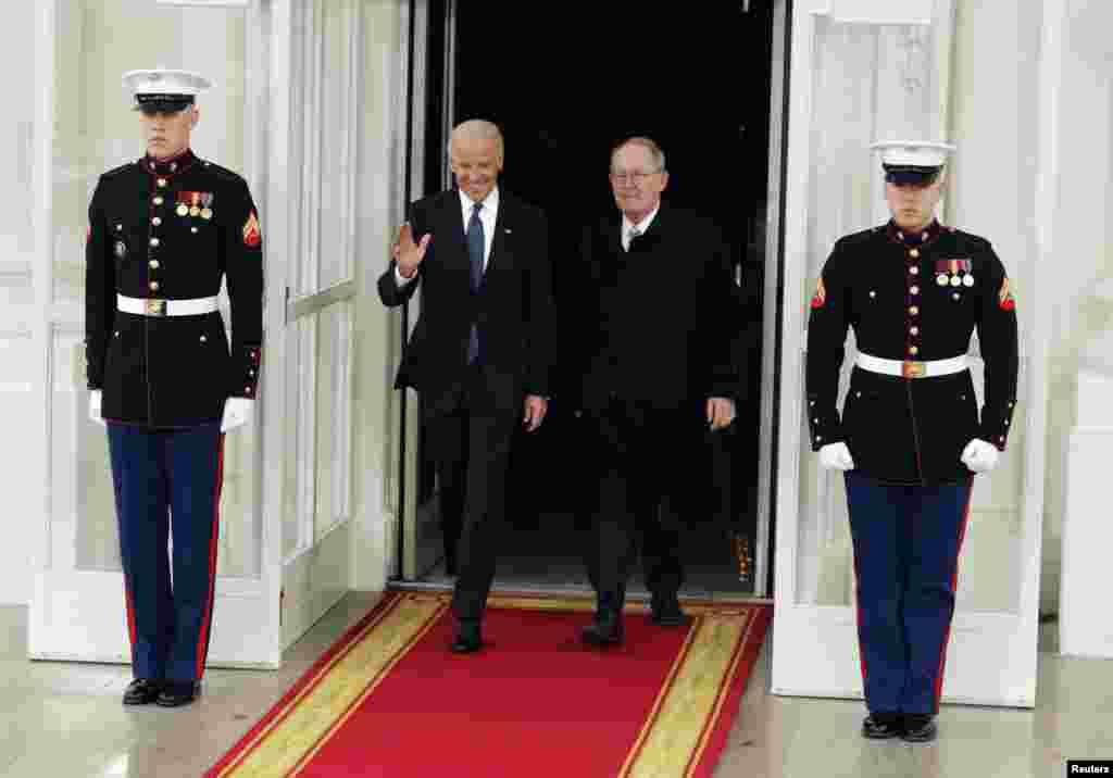 U.S. Vice President Joseph Biden (L) departs the White House with Senator Lamar Alexander (R-TN) in Washington January 21, 2013