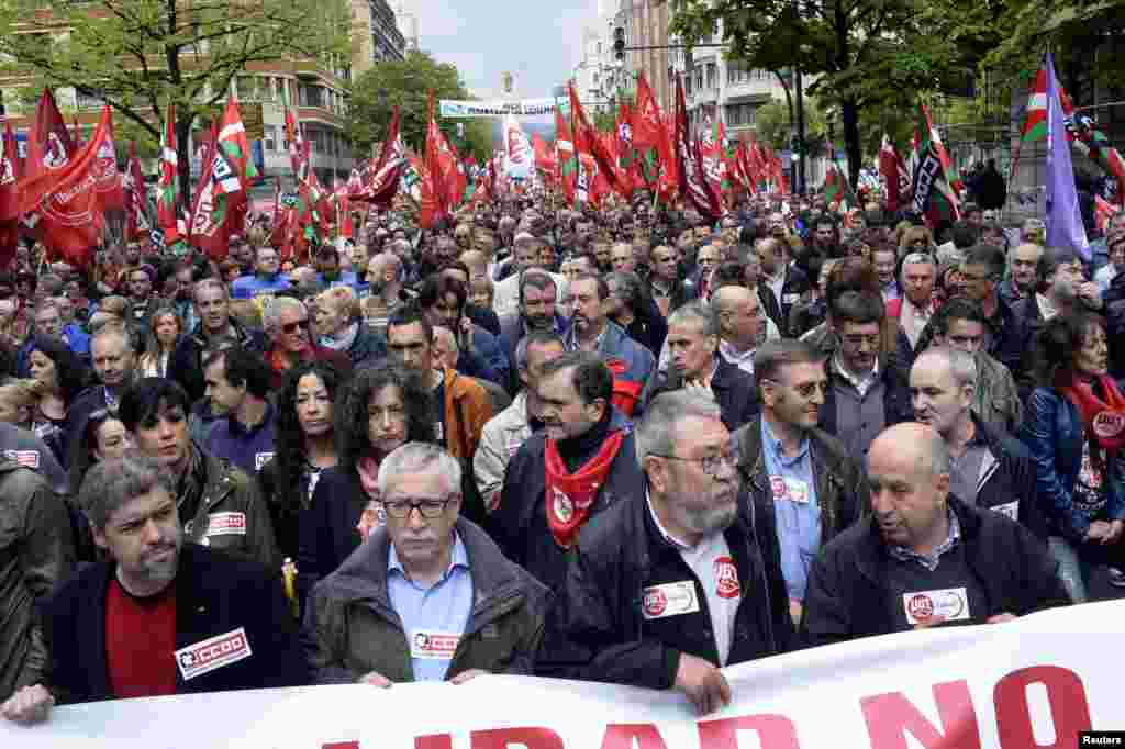 Ignacio Fernandez Toxo (2nd L) and Candido Mendez (2nd R), general secretaries of Spain's leading trade unions CCOO and UGT, march as they are flanked by Basque CCOO and UGT leaders Unai Sordo (L) and Raul Arza during May Day celebrations in Bilbao.