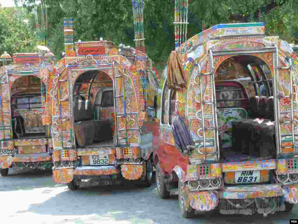 Heavily-painted small buses, Islamabad, Pakistan, July 10, 2012. (S. Gul/VOA)