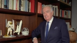 Former CBS anchorman Walter Cronkite poses near space memorabilia in his New York office, 1995