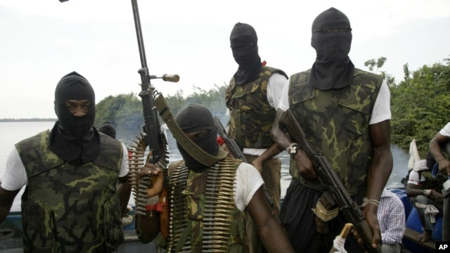 Members of Movement for the Emancipation for the Niger Delta, (MEND) a militant group patrol the creeks in the Niger Delta area of Nigeria, in this Feb. 24, 2006 file photo.