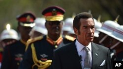 FILE: President Lt Gen. Seretse Khama Ian Khama, right, attends a swearing-in ceremony for a second and final term as Botswana president at the National Assembly buildings in Gaborone, Botswana, Oct. 28 2014.