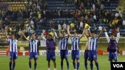 Les joueurs du FC Porto célèbrent leur qualification pour la finale de la Ligue Europa face au Villarreal en 2012 au stade Madrigal, en Espagne.