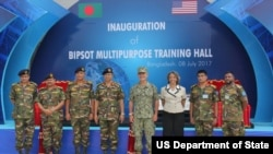 Bangladesh Army Chief General Abu Belal Muhammad Shafiul Huq, U.S. Admiral Harry B. Harris Jr., Ambassador Marcia Bernicat, and Bangladeshi service men attend the Inauguration of the BIPSOT Multipurpose Training Hall in Bangladesh, 08 July, 2017.