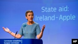 "FILE - An Aug. 30, 2016, photo shows European Union Competition Commissioner, Margrethe Vestager, speaking at EU headquarters in Brussels. Vestager, who ruled against Apple in a tax case, said she was ""absolutely certain that the decision on Deutsche Bank is built on the facts of the case and American legislation."""