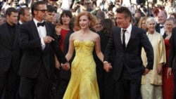 From left, actors Brad Pitt, Jessica Chastain and Sean Penn arrive for the screening of 'The Tree of Life' at Cannes international film festival last May