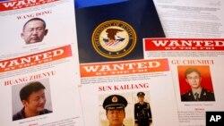 Fotos de algunos de los militares chinos identificados en la acusación.