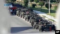 叙利亚在中部城市霍姆斯部署的军车(资料照片)