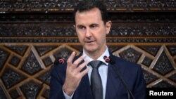 Le président syrien Bachar al-Assad parle aux membres du Parlement à Damas, le 7 Juin 2016.
