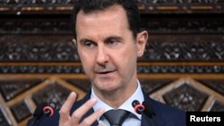 FILE - Syrian President Bashar al-Assad