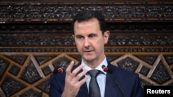 FILE - Syrian President Bashar al-Assad speaks to Parliament members in Damascus in this photo handed out by SANA, the Syrian Arab News Agency, June 7, 2016.