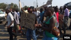 Suspected MDC youths demonstrate in Harare demanding an election re-run