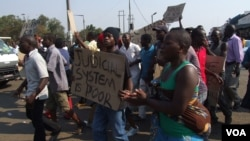 Suspected MDC youths demonstrating in Harare demanding an election re-run