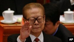 FILE - Former Chinese President Jiang Zemin gestures during the opening session of the 18th Communist Party Congress held at the Great Hall of the People in Beijing, China.