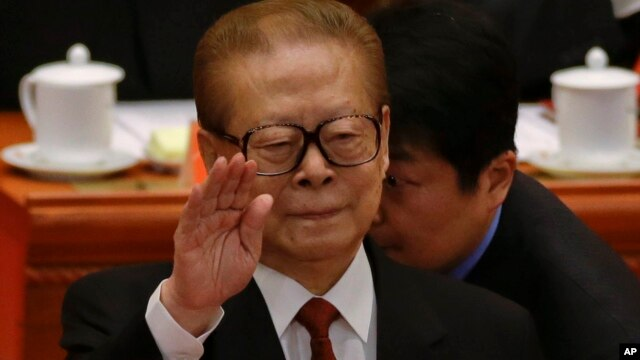 Former Chinese President Jiang Zemin gestures during the opening session of the 18th Communist Party Congress in Beijing, China, Nov. 8, 2012.