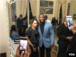 NFL star, Haitian-American Pierre Garcon poses for a photo with Miss Black America, Brittany Lewis at the Haitian Embassy's fashion event in Washington, D.C., Feb 23, 2018. (VOA / S. Lemaire)