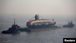 India's third Scorpene-class submarine INS Karanj is seen as a tugboat pulls it during its launch at the Mazagon Dock Ltd. naval shipbuilding yard, in Mumbai, India January 31, 2018.