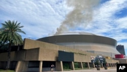 Smoke rises from roof at New Orleans' Superdome in New Orleans, Sept. 21, 2021, in this photo provided by New Orleans fire department.