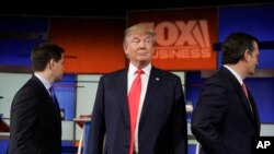 Republican presidential candidate, businessman Donald Trump stands on the stage before the Fox Business Network Republican presidential debate at the North Charleston Coliseum, Thursday, Jan. 14, 2016.