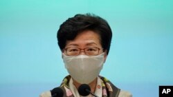 """Hong Kong Chief Executive Carrie Lam listens to reporters questions during a press conference in Hong Kong, Tuesday, June 2, 2020. Lam hit out at the """"double standards"""" of foreign governments over national security, and pointed to recent unrest in…"""
