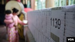 FILE: A Cambodian women is checking her name on the voter list at a polling station in Phnom Penh, Cambodia, June 2017. (Hean Socheata/VOA Khmer)