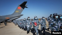 Medical personnel arrive in transport aircraft of the Chinese People's Liberation Army (PLA) Air Force at the Wuhan Tianhe International Airport following the outbreak of the novel coronavirus in Wuhan, Hubei province, China February 17, 2020. China…