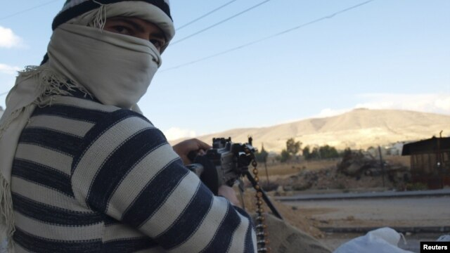 Free Syrian Army fighters are seen in Daria near Damascus, Syria, November 25, 2012.