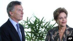 Brazil's President Dilma Rousseff receives Argentina's President-elect Mauricio Macri at the Planalto Presidential Palace, in Brasilia, Brazil, Dec. 4, 2015.