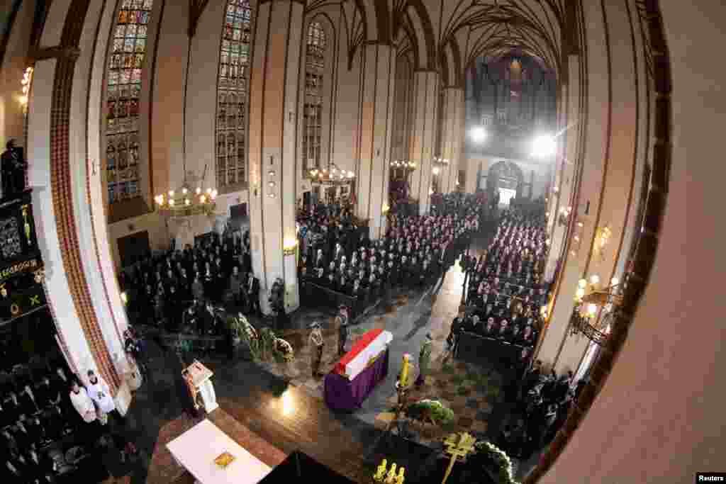 The coffin of Poland's first non-communist prime minister Tadeusz Mazowiecki is seen covered with a Polish national flag during his funeral at St. John's Archcathedral in Warsaw.