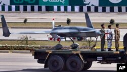 FILE - Pakistan's first locally manufactured armed drone aircraft is loaded on a vehicle during the Pakistan National Day parade in Islamabad, Pakistan, March 23, 2015.