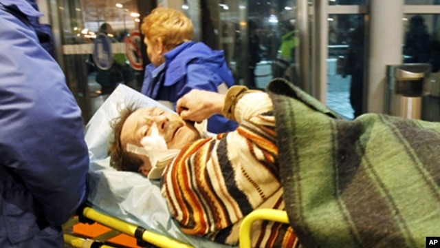 Medics wheel a victim of a bomb explosion at Moscow's Domodedovo airport, 24 Jan 2011