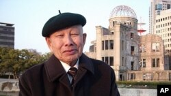Hiroshima bomb survivor Keijiro Matsushima in the shadow of the A-bomb (atomic bomb) dome
