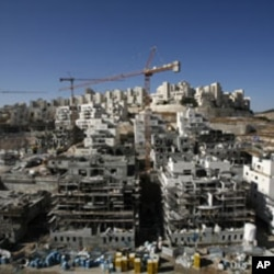 Houses under construction are seen in a Jewish settlement near Jerusalem known to Israelis as Har Homa and to Palestinians as Jabal Abu Ghneim, 08 Dec 2010