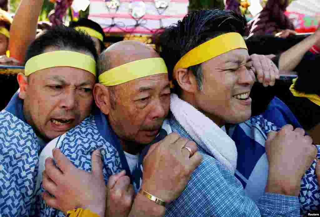 People carry a portable shrine, a Mikoshi, at the Senso-ji Temple during the Sanja festival in Asakusa district in Tokyo, Japan.