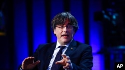 Member of European Parliament Carles Puigdemont speaks during an interview at the European Parliament in Brussels, Tuesday, March 9, 2021. The European Parliament on Tuesday voted to lift the immunity of the former president of Spain's Catalonia region,…