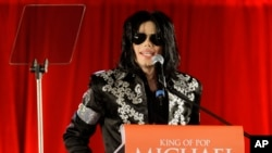 FILE - Singer Michael Jackson announces that he will play 10 live concerts in London, March 5, 2009. Forbes magazine put the King of Pop's earnings for the year ending October 1 at $825 million.