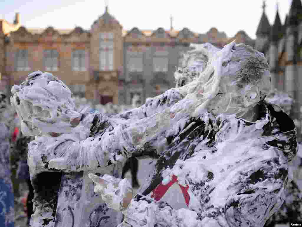 Students from St. Andrews University are covered in foam as they take part in the traditional 'Raisin Weekend' in the historic St. Salvator's Quad, in St Andrews, Scotland.