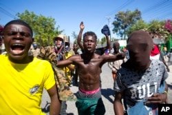 Protesters chant anti-government slogans demanding the resignation of President Jovenel Moise in Port-au-Prince, Haiti, Feb. 11, 2019.